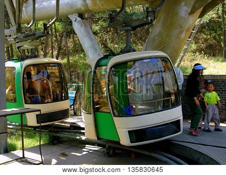 Badaling China - May 2 2005: Cable cars arriving at the base station whisk passengers up to the Great Wall of China