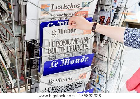 Woman Buying Le Monde Newspaper With Shocking Headline About Brexit