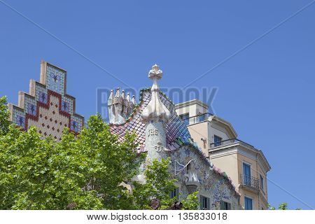 BARCELONA SPAIN - MAY 11 2016 : View on Casa Batllo with chimneys with ceramic mosaic. Building redesigned in 1904 by Gaudi located in the center of Barcelona it is on the UNESCO World Heritage Site.