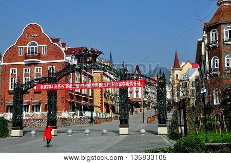 Bai Lu China - November 17 2013: Wrought iron gates lead into the principal street lined by Alsatian style buidings in the Sino-French village