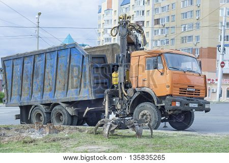 KAMAZ trucks with manipulator (loader) in the city of Cheboksary Chuvash Republic Russia. Work on a city street. 07/05/2016