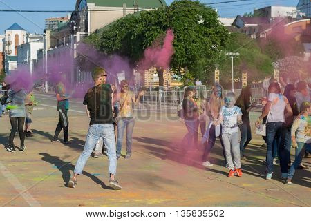 The Guy Threw Paint Into A Crowd Of Holy In Cheboksary, Chuvash Republic, Russia At The Festival Of