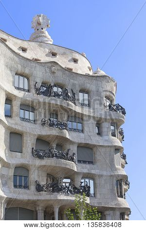 BARCELONA, SPAIN - MAY 13  2016 : Casa Mila known as La Pedrera - facade with balconies. Modernist building designed by architect Antoni Gaudí, and was built from 1906 to 1912.