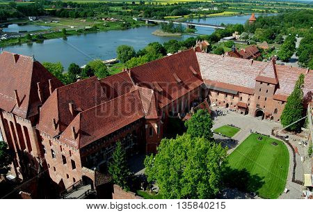 Malbork Poland -May 29 2010: Courtyard High Castle at 14th-15th century Malbork Castle once the domain of the Teutonic Knights and Europe's largest medieval castle situated next to the River Nogat