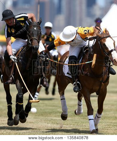 JERSEY CITY, NJ-MAY 30: Javier Tanoira (L) and Marcos Garcia Del Rio Figueras fight for the ball during the Veuve Clicquot Polo Classic at Liberty State Park on May 30, 2015 in Jersey City, NJ.
