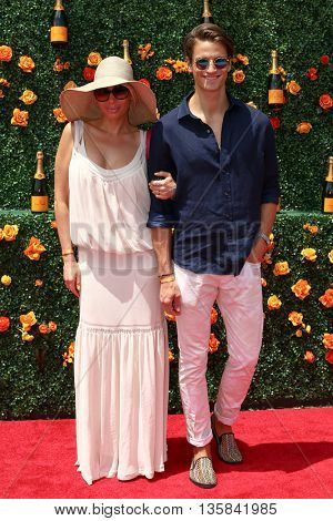 JERSEY CITY, NJ - MAY 30: Elena Aleksandrova (L) and David Florentin attend the 8th Annual Veuve Clicquot Polo Classic at Liberty State Park on May 30, 2015 in Jersey  City, New Jersey.