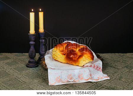 Sabbath image. challah bread, sabbath wine and candelas on wooden table. glitter overlay Saturday Sabbath