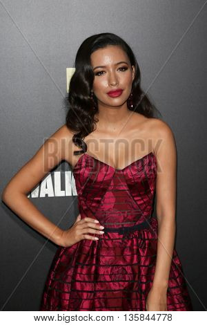 NEW YORK-OCT 9: Actress Christian Serratos attends AMC's 'The Walking Dead' season six premiere at Madison Square Garden on October 9, 2015 in New York City.