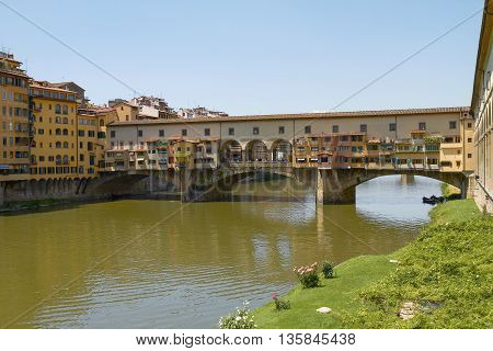 FLORENCE ITALY - JUNE 5 2010: Tourists Enjoying Vacation at Ponte Vecchio in Florence Italy