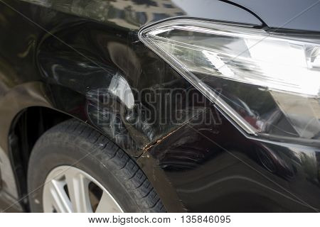New beautiful black car hited by tree