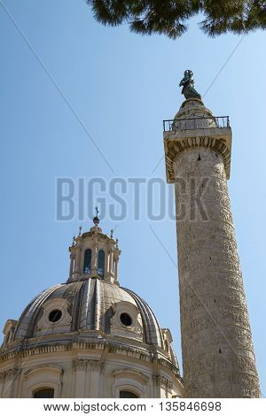 Old Monument and Column of Trajan in the Imperial Forums in Rome Italy