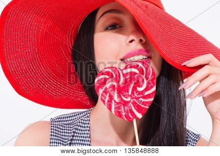 Be hypnotized. Portrait of pleasant delighted magnetic woman looking at you and eating lollypop while seducing