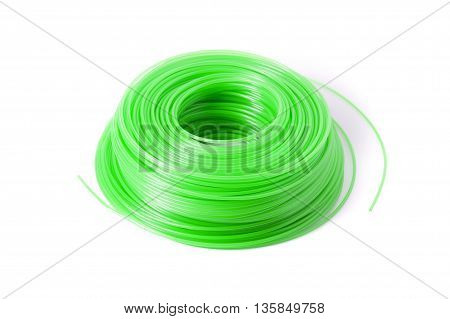 A spool of green trimmer line for a weed eater.