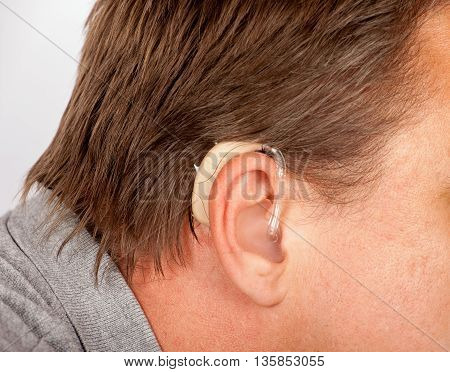 Close up of a senior mans ear with hearing aid