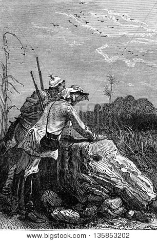 Soldier explorer and Makololo tribe native hunter watchingfrom a distance using a telescope in South Africa. It is as you see it. Jules Verne 3 Russians and 3 English Book, vintage engraving, 1871.
