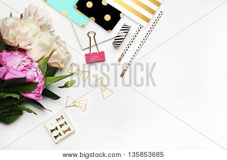 Flat lay, office desktop, peonies, view table, up. polka pattern gold black and mint. Feminine scene