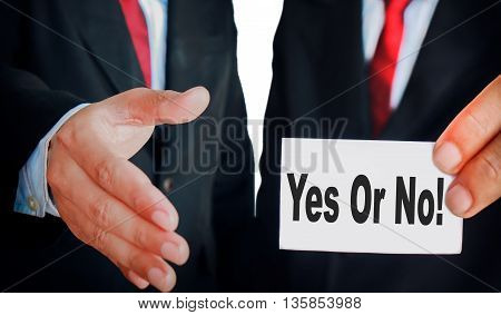 Businessman showing sign handshake with paper write