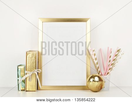 gold picture frame with decorations. Mock up for your photo or text Place your work, print art,shabby style, white background, paper ball, toy, pastel color book poster