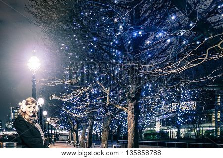 Girl Near A Tree With Christimas Lights
