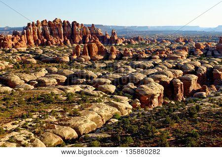 Sunrise Illuminates Dramatic Sandstone Formations.  Chesler Park, Canyonlands National Park, Utah, USA