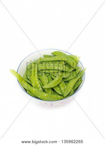 Green peas in a bowl, sugar Pea, Sweet peas, Garden Pea, snow peas on white background.