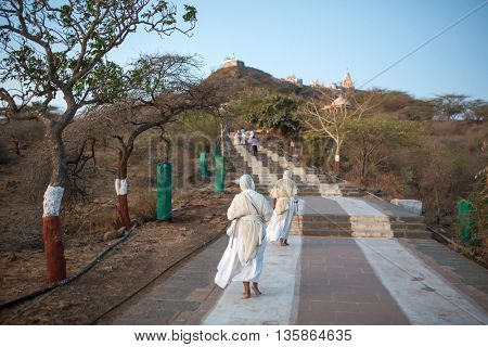 Palitana, India - March 6, 2016: Jain nuns on parikrama, walking pilgrimage, to Jain temples on top of Shatrunjaya hill, Palitana (Bhavnagar district), Gujarat, India