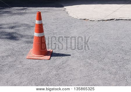 Traffic Cone On Road Construction Site.