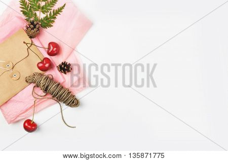 white background table, envelope and cherry, invitation
