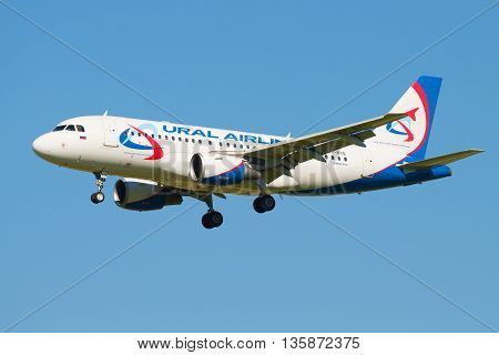 SAINT PETERSBURG, RUSSIA - AUGUST 21, 2015: The aircraft A319-112 (VP-BTE) Ural Airlines airline flies away in the cloudless blue sky