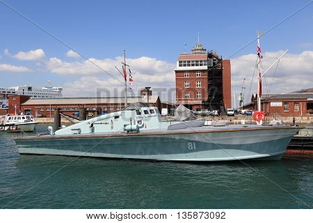 PORTSMOUTH UK - JUNE 12 2014: View of Portsmouth historical dockyard on June 12 2014 in Portsmouth UK. Historical warships of the UK royal navy are displayed in the dockyard.