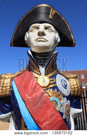 PORTSMOUTH UK - JUNE 12 2014: Statue of Admiral Lord Nelson on June 12 2014 in Portsmouth UK. The statue is displayed in Portsmouth historical dockyard to commemorate this national hero.