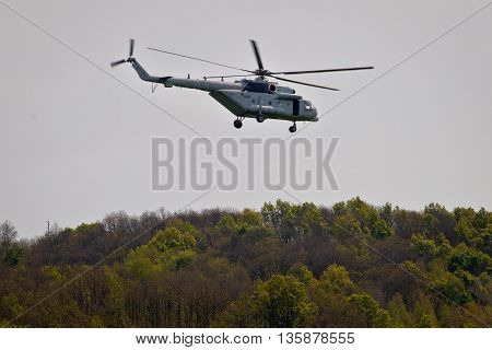Military helicopter above forest view Mi-8 transponter