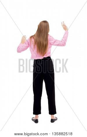 Back view business woman. Raised his fist up in victory sign. Raised his fist up in victory sign. Rear view people collection. isolated over white. girl office worker in black trousers dancing
