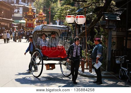 Peope On Rickshaw Attend Floating Puppet Festival In Takayama