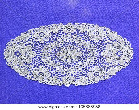 White Doilie Over Light Blue Background