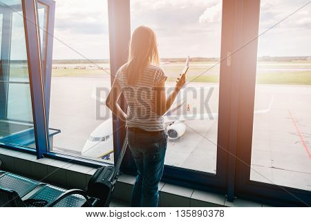 Woman Books A Flight With The Smartphone