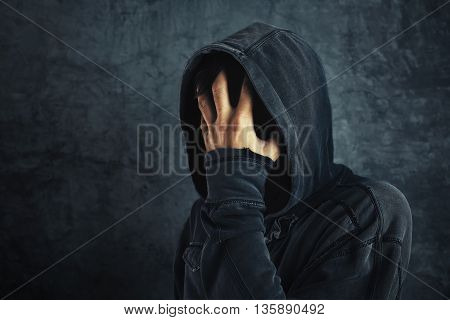 Hooded person fighting addiction crisis drug or alcohol addict in abstinence period