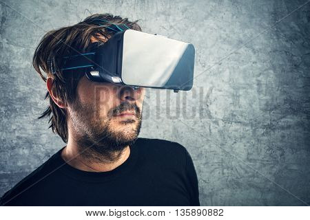 Adult man with 3d VR goggles enjoying virtual reality modern futuristic technology gadget