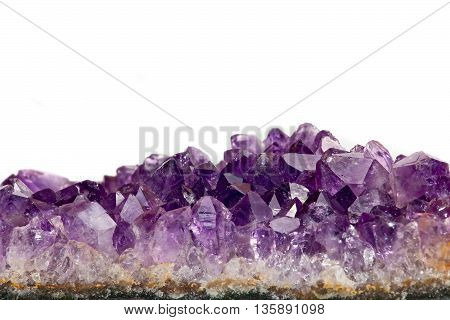 amethyst on a white background. photo Close-up
