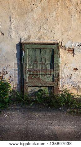 old green door in the stone wall