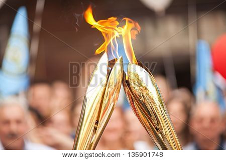 Sports relay. Sports torch relay. Sport symbol. Symbol of sports fulfillments. Fire transfer. poster