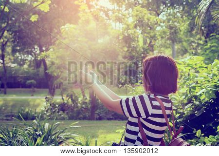 woman respect and pray on the sunset in nature,a hand of hopefully held up high,hope concept
