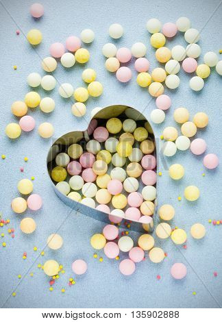 Love background sweet sugar colorful candy and heart selective focus