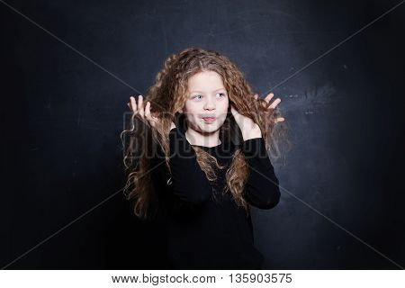 Redhead Child Girl. Cute Child with Long Red Hair