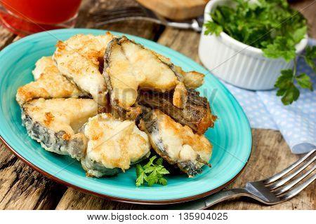 Fried fish sea rabbit (chimera fish sea rat) selective focus