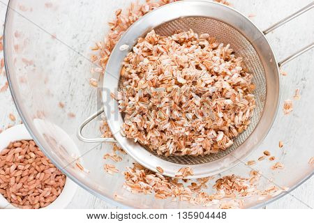 Exclusive red rice varieties devzira. Process of cooking traditional pilaf preparation rice ingredient