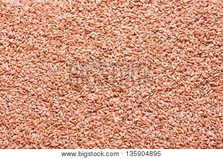 Red rice devzira as a food background