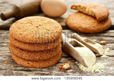 Soft American cookies from corn flour on old wooden table selective focus