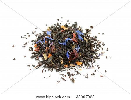 Black tea blend with dried fruits and cornflower isolated on white background