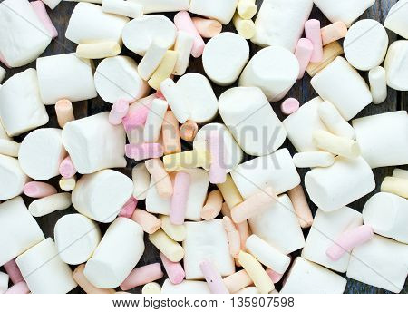 Fluffy marshmallows as a background. Sweet food candy background as poster wallpaper backdrop top view